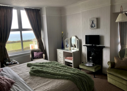 Room 4 double bed and furniture